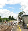 Eccles Road Station - opening of the crossing gates - geograph.org.uk - 1398996.jpg