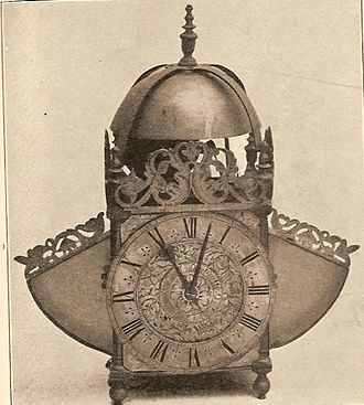 "Pendulum clock - A lantern clock that has been converted to use a pendulum. To accommodate the wide pendulum swings caused by the verge escapement, ""wings"" have been added on the sides"