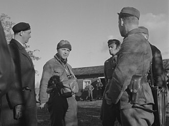 Eliot Elisofon - Mr. Elisofon (standing in the middle) during Lapland War in Finland.