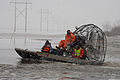 FEMA - 40379 - Search and Rescue volunteers on an airboat in Minnesota.jpg