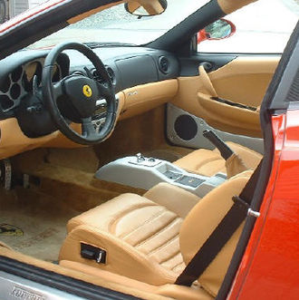 "Ferrari 360 - Interior of the Modena with rosso corsa paint and tan leather. This example is equipped with the F1 gearbox, controlled by the ""paddles"" on the steering column"