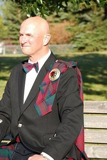 Fly plaid length of tartan cloth worn pinned to the left shoulder, usually with a kilt