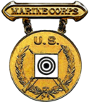 Former USMC Gold Rifle Marksmanship Competition Badge.png