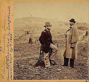 Battle of Fort Sanders - U. S. Engineers Orville E. Babcock, left, seated on a tree stump, and Orlando Poe, right, standing on a war damaged salient in Fort Sanders, Knoxville, Tennessee.