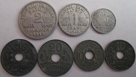 Vichy French zinc and aluminium coins made during the war. These coins circulated in both the German-occupied zone and unoccupied zone. French coins zinc & aluminum World War II 1940s.jpg