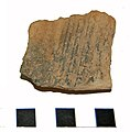 GLO-605CE3 Fragment of hypercourse or flue tile (FindID 548463).jpg