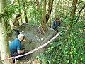 GT staff and volunteers smoothing surface of mud sofa.jpg