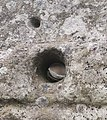 Gallen Priory Early Monastic Site Pillar West Face Hole 2010 09 10.jpg
