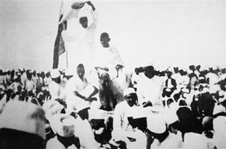 Salt March - Gandhi at a public rally during the Salt Satyagraha.