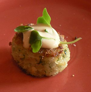 a garnished crabcake.