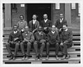 George Washington Carver, full-length portrait, seated on steps, facing front, with staff LCCN2004671560.jpg