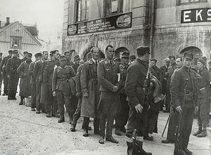 Skorpa prisoner of war camp - German prisoners of war under guard in Harstad, Northern Norway, in May 1940