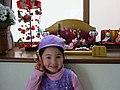 Girl standing in front of Japanese dolls, 2006.jpg