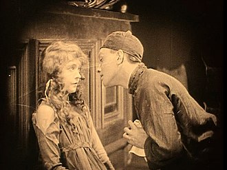 Silent film - A scene from Broken Blossoms starring Lillian Gish and Richard Barthelmess—an example of a sepia-tinted print.