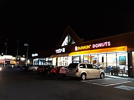 Greenbriar Shopping Center Dunkin' Donuts at night, lighter version.jpg