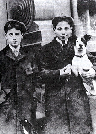 Marx Brothers - Julius Henry Marx (Groucho) on the left and Adolph Marx (Harpo) on the right holding a rat terrier dog, c. 1906