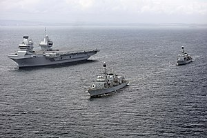 Her Majesty's Naval Service - Image: HMS Queen Elizabeth (R08) underway during trials with HMS Sutherland (F81) and HMS Iron Duke (F234) on 28 June 2017 (45162784)