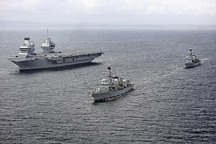HMS Queen Elizabeth, a Queen Elizabeth-class supercarrier on sea trials in June 2017 HMS Queen Elizabeth (R08) underway during trials with HMS Sutherland (F81) and HMS Iron Duke (F234) on 28 June 2017 (45162784).jpg