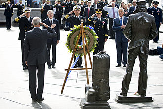 Washington Navy Yard shooting - Defense Secretary Chuck Hagel and others lay a wreath at the Navy Memorial on September 17 in honor of the victims.
