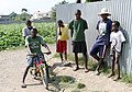 Haitians wait outside UN compound (4295288253).jpg