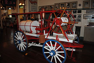Jacksonville Fire and Rescue Department - An antique hand pumper on display at the Jacksonville Fire Museum