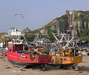 Two of Hastings' beach-launched fishing fleet with part of Old Town and East Cliff Railway in background