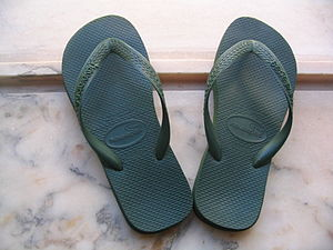 The flip-flop sandal, worn both by men and women.