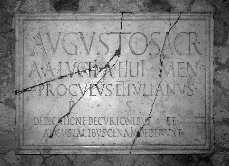 A Roman marble sign in the Collegio degli Augustali in Herculaneum, Italy, with an honorary inscription in Latin. - Wikipedia