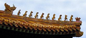 Pixiu - Ceramic figures decorating the Hall of Supreme Harmony at the Imperial Palace Museum. The 10 mystical beasts indicate the highest status in the empire for this building. Picture taken late September 2002 by Leonard G.