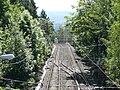 Holmenkollbanen trakcs and trees.jpg