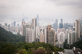 Tilt–shift photography -  Example for a photograph taken with a tilt-shift lens. The lens was shifted downwards to avoid perspective distortion: all vertical lines of the skyscrapers run parallel to the edges of the image. The picture shows Hong Kong viewed from Victoria Peak.