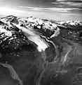 Hook Glacier, valley glacier terminus partially covered in dark bands of rock and debris, August 16, 1969 (GLACIERS 6653).jpg
