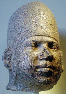 Pink granite head identified as Huni, Brooklyn Museum
