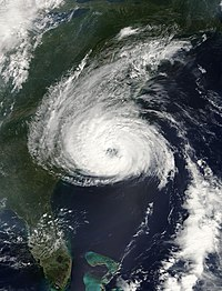 Satellite image of a tropical cyclone near the United States east coast. It presents a pronounced eye feature.