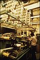 INTERIOR OF THE 3M CO.(MINNESOTA MINING AND MANUFACTURING) PLANT SHOWING AN EMPLOYEE WORKING ON ONE OF THE MACHINES.... - NARA - 558373.jpg