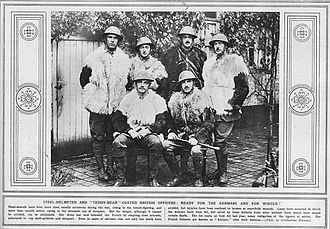 """Brodie helmet - The Illustrated War News—17 November 1915 The caption reads:  Head-wounds have been more than usually numerous during the war, owing to the trench-fighting, and more than usually severe, owing to the extensive use of shrapnel. But the danger, although it cannot be avoided, can be minimised. Our Army has now followed the French by adopting steel helmets, calculated to stop shell-splinters and shrapnel. Even in cases of extreme risk, not only has death been avoided, but injuries have been confined to bruises or superficial wounds. Cases have occurred in which the wearers have been hit, but saved by these helmets from what without them would have meant certain death. The fur coats, as they did last year, mean mitigation of the rigours of winter. The French helmets are known as """"Adrians,"""" after their inventor. (Photo by Illustrations Harrow)."""