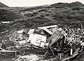 In IJmuiden werden de Consumptiekramen, die aan de voet van de Zuiderpier stonden, de duinen ingeslingerd door de storm. Aangekocht in 1976 van fotograaf C. de Boer. Identificatienummer 54-0, NL-HlmNHA 1478 25900 K 38.JPG