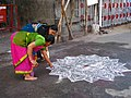India - Sights & Culture - Women drawing an intricate kolam outside the Mylapore Temple (2278407131).jpg
