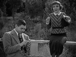 with co-star Clark Gable in It Happened One Night (1934)