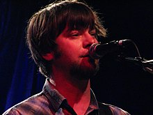 Jay Farrar singing into a microphone