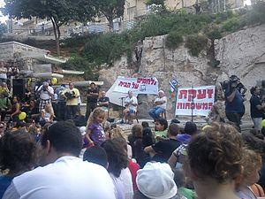 Yossi Abulafia - David Grossman, Meir Shalev and Yossi Abulafia at the real estate protest in Gan Hasus, Jerusalem, 31.7.2011