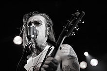 Jesse Hughes from the Eagles of Death Metal playing the Commodore Ballroom on July 20th 2009.jpg