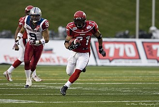 Canadian football - The Calgary Stampeders (at right, in red) versus the Montreal Allouettes.