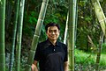 Joi with backyard bamboo.jpg