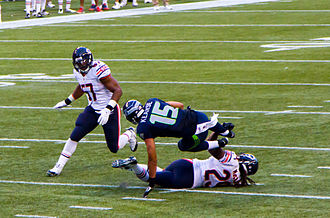 Jon Bostic - Bostic (left) in 2014 against the Seattle Seahawks.