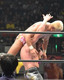 Resultados NXT TAKE OVER, VENGEANCE DAY! 210px-Kenny_Omega_Katayoku_no_Tenshi