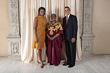 Photograph of U.S. President Barack Obama and First Lady Michelle Obama at the Metropolitan Museum of Art with Olubanke King Akerele in 2009