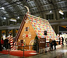 a full scale gingerbread house as a christmas decoration in stockholm 2009 it was made of 6481 pounds 294 kg flour 2028 lb 920 kg margarine