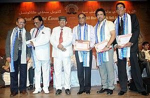 Govinda with five other men onstage
