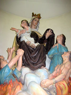 Scapular of Our Lady of Mount Carmel - In this statue of Our Lady of Mount Carmel with the Infant Jesus at Saint Leonard of Port Maurice Church, one of the souls in purgatory begging for Mary's intercession appears to be wearing a Scapular of Our Lady of Mount Carmel.